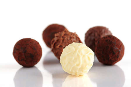Several assorted chocolate truffles isolated on white background Stock Photo - 2346914