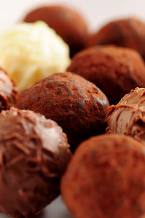 Several assorted gourmet chocolate truffles close up
