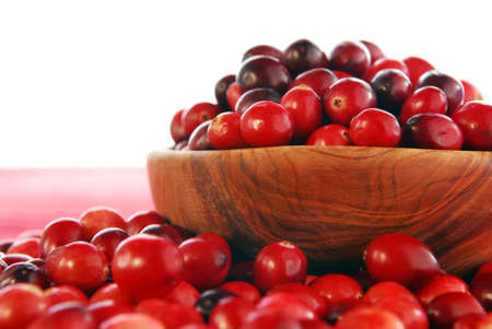 Fresh red cranberries in a wooden bowl photo