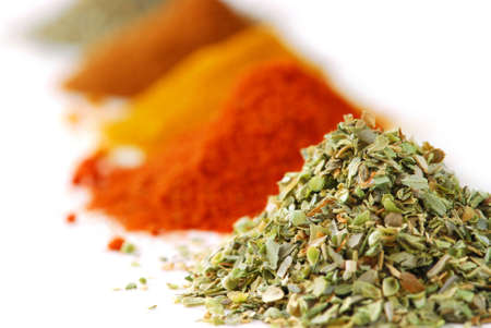 Heaps of various ground spices on white background photo