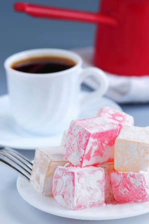 Turkish delight (lokum) confection with black coffee and traditional coffee pot photo