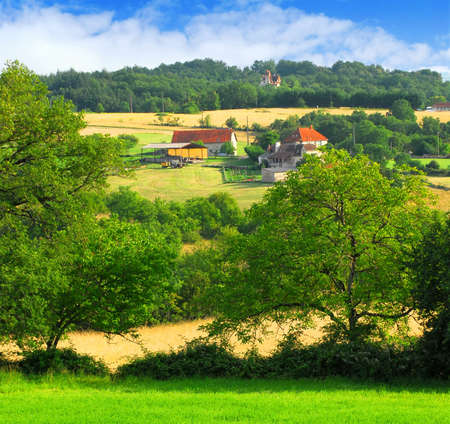 Scenic view on summer agricultural landscape in rural France with a farmhouse and barn Stock Photo - 2393069