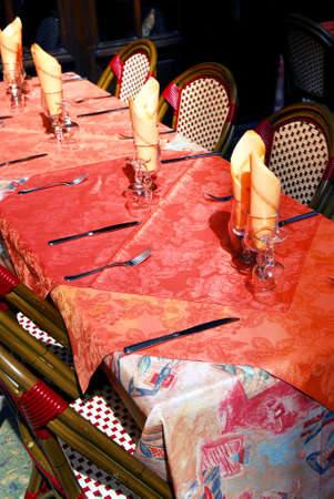 Set table with tablecloth and glasses on restaurant outdoor patio photo