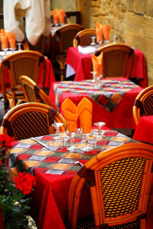 Set tables with tablecloth and glasses on restaurant outdoor patio photo