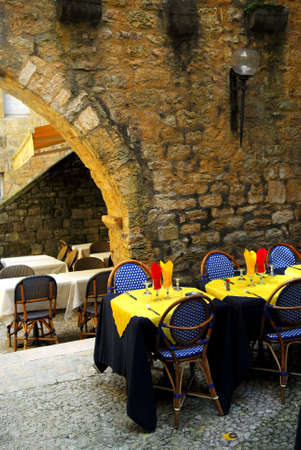 Restaurant patio among medieval walls in Sarlat, Dordogne region, France