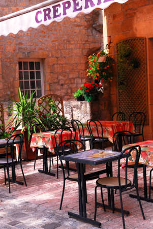 Restaurant patio in medieval town of Sarlat, France photo