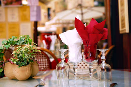 Outdoor restaurant patio on the street of Sarlat, Dordogne region, France photo