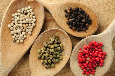pungent: Four kinds of peppercorns in wooden cooking spoons