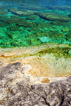 Rock and clear water of Georgian Bay at Bruce peninsula Ontario Canada photo