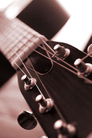 guitar tuner: Headstock and tuners of an acoustic guitar close up  Stock Photo