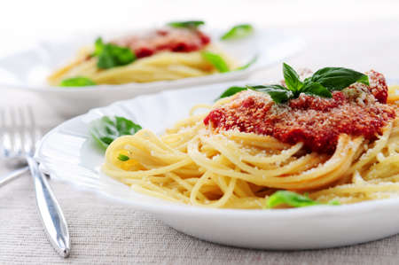 pasta dish: Pasta with tomato sauce basil and grated parmesan Stock Photo
