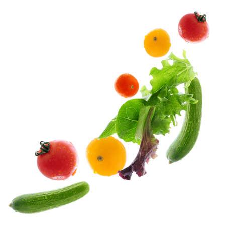 Assorted fresh vegetables flying isolated on white background Stock Photo - 2537511