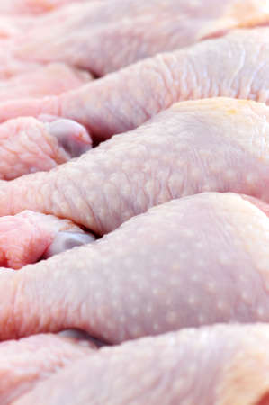 Raw chicken drumsticks in a supermarket package Stock Photo - 2567802
