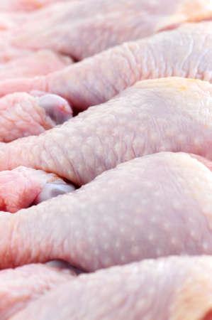 Raw chicken drumsticks in a supermarket package Stock Photo - 2567802