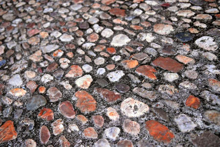 Abstract background of old medieval cobblestone pavement photo