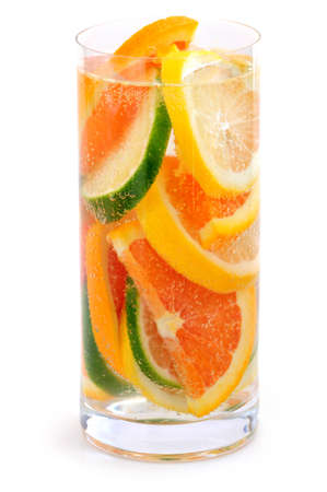 Bubbly beverage with citrus slices isolated on white background photo
