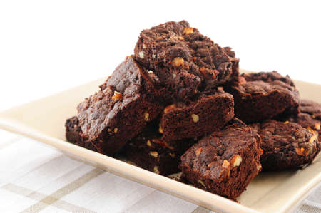 brownies: Homemade chocolate brownies served on a plate