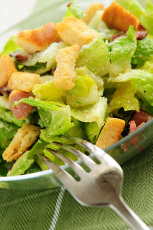 Fresh caesar salad served in a glass bowl photo