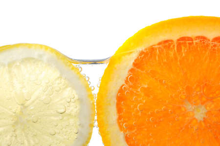 Orange and lemon slices in water with air bubbles on white background Stock Photo - 2668184
