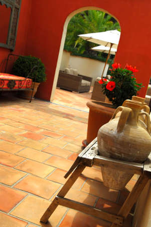 Courtyard of mediterranean villa in French Riviera. Shallow depths of filed, focus on amphoras. Imagens