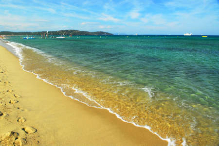 Footprints on the golden sand of famous Pampelonne beach near St. Tropez in French Riviera photo