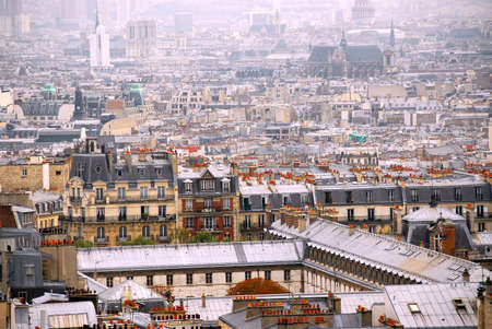 top: Scenic view on Paris rooftops and cathedrals Stock Photo