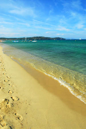 tropez: Footprints on the golden sand of famous Pampelonne beach near St. Tropez in French Riviera
