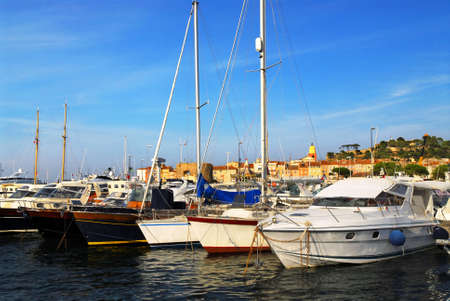Luxury boats at the dock in St. Tropez in French Riviera photo