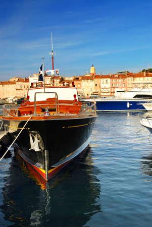 Luxury boats docked in St. Tropez in French Riviera photo