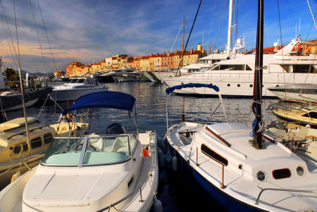 tropez: Luxury boats docked in St. Tropez in French Riviera Stock Photo