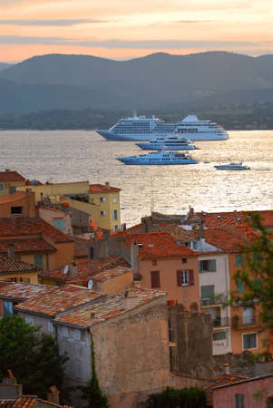 Cruise ships at St.Tropez at sunset in French Riviera photo