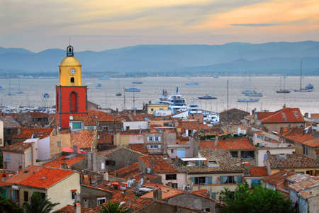 french riviera: View at St.Tropez and anchored ships at sunset in French Riviera