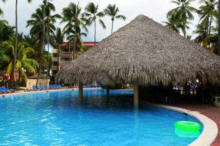 Swimming pool with swim up bar at tropical resort