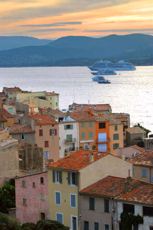 cote d'azur: View at St.Tropez and cruise ships at sunset in French Riviera