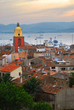 tropez: View at St.Tropez and anchored ships at sunset in French Riviera