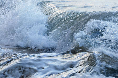 wave crest: Big crashing waves in a stormy ocean Stock Photo