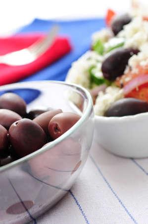 kalamata: Black kalamata olives and greek salad with feta cheese  Stock Photo