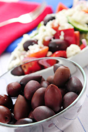Black kalamata olives and greek salad with feta cheese photo