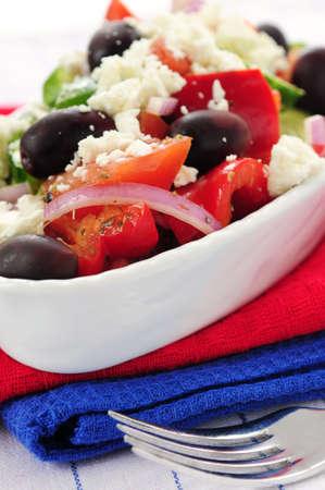 Greek salad with feta cheese and black kalamata olives photo