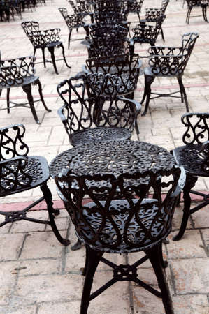 outdoor cafe: Wrought iron furniture on the outdoor cafe patio