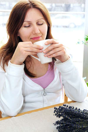 Mature woman relaxing at home holding a cup Stock Photo - 2923946