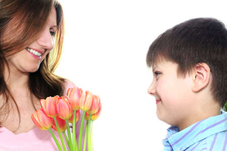 Mother receiving a bouquet of flowers from her son