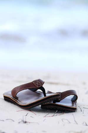 Flipflops on a sandy ocean beach - summer vacation concept Stock Photo - 2923875
