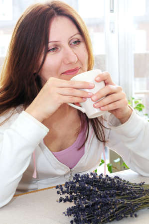 Mature woman relaxing at home holding a cup Stock Photo - 2956625
