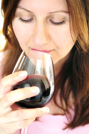 Mature woman holding a glass of red wine Stok Fotoğraf