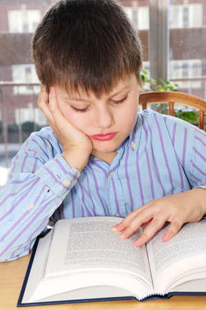 Serious school boy studying with a book Stock Photo - 3010120