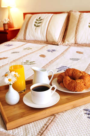 continental: Tray with breakfast on a bed in a hotel room
