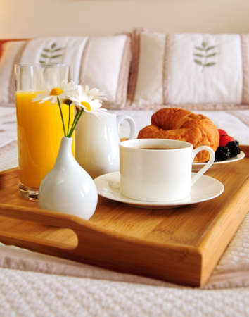 luxuries: Tray with breakfast on a bed in a hotel room
