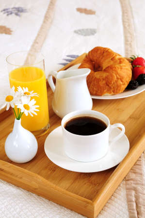 Tray with breakfast on a bed in a hotel room Stock Photo - 3051554