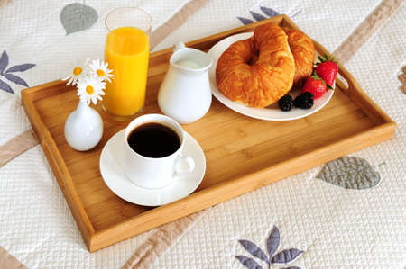 Tray with breakfast on a bed in a hotel room Stock Photo - 3051648